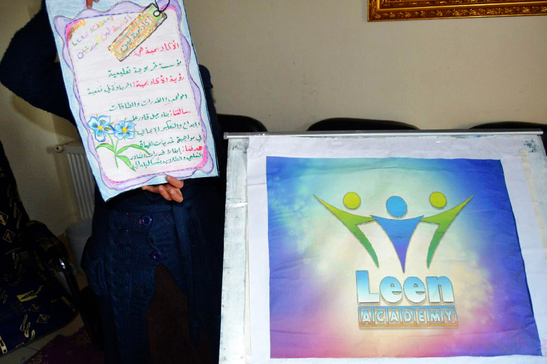 Shams showing the posters she has done in the institution. Moadamiyeh 2016. Photo: private